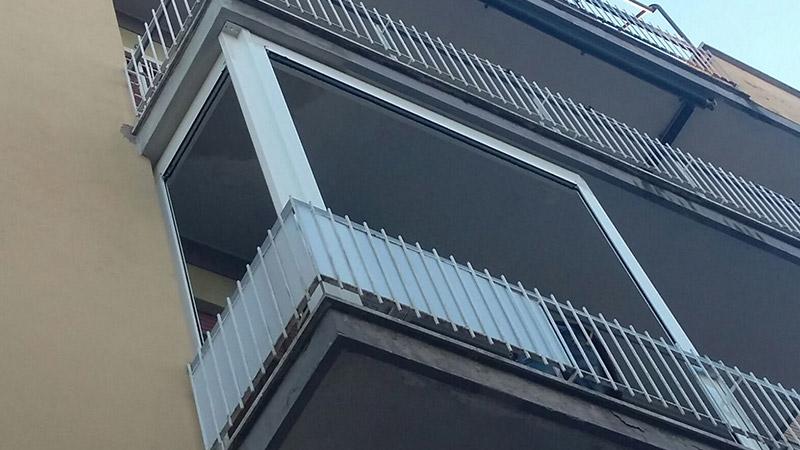 Chiusure perimetrali balcone condominiale